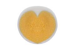 煮沸的鸡鸡蛋用心形的蛋黄,隔绝在白色 免版税图库摄影