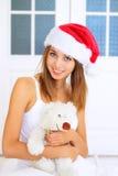 熊女孩帽子圣诞老人女用连杉衬裤 库存图片