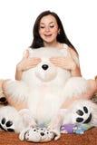 熊女孩演奏俏丽的女用连杉衬裤 库存图片