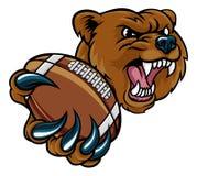 熊美国举行的橄榄球球 库存例证