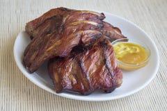 熏制的烤猪肉肋骨 库存照片