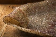 熏制的猪肉皮肤soric在木头 库存照片
