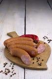 香肠、干胡椒和辣椒 免版税库存照片