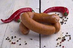 香肠、干胡椒和辣椒 库存照片