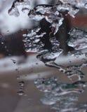 熔化在玻璃 免版税库存照片
