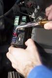 熔化箱子在汽车的帽子下 免版税库存图片