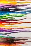 熔化蜡笔五颜六色的摘要绘了在帆布的背景 免版税库存图片