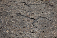 熔岩刻在岩石上的文字 免版税库存照片