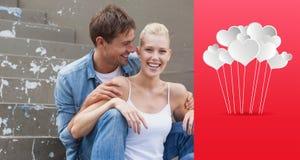 熟悉内情的年轻夫妇的综合图象在牛仔布的坐步 免版税库存图片