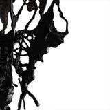 黑燃料油飞溅 免版税图库摄影