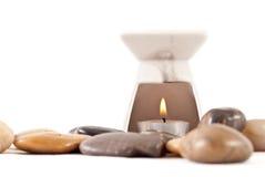 燃烧器蜡烛于被点燃的油 免版税库存照片