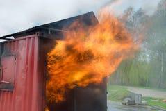 燃烧的容器火 免版税库存照片