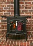 燃烧的被塑造的老火炉木头 库存照片