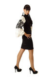 燕尾服的新美丽的妇女 免版税库存图片