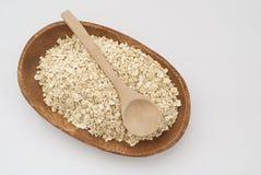 燕麦和木匙子 免版税库存照片
