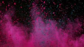 爆炸在超级慢动作的黑背景的五颜六色的粉末 股票录像