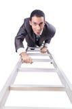 爬梯子的商人 免版税库存图片
