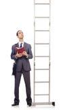 爬梯子的生意人 库存图片
