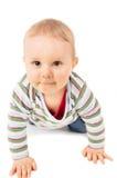 爬行在地板上的婴孩 免版税库存图片