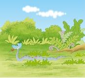爬行在热带森林植物群落的蛇 免版税库存照片