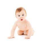 爬行的好奇婴孩 免版税库存照片