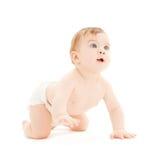 爬行的好奇婴孩 免版税库存图片