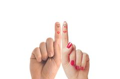 爱上被绘的面带笑容的手指愉快的夫妇 免版税库存照片