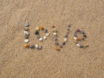 爱写与石头和壳 库存照片