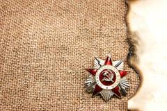 爱国战争的顺序在被烧的纸的 免版税库存照片