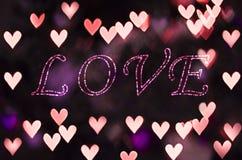 爱在心脏bokeh -情人节背景 库存图片