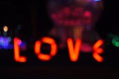 爱在黑背景的词的Bokeh形式 库存照片