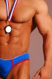 爱好健美者浅黄色的男性奖牌 免版税库存图片