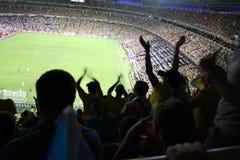 爱好者的喜悦在橄榄球的 免版税库存图片