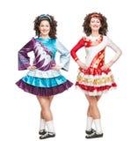 爱尔兰人舞蹈的两个少妇穿戴摆在被隔绝 免版税图库摄影