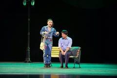 爱故事江西OperaBlue外套的一个小职员 免版税库存照片