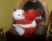 爱是…在白色背景的桃红色标志 库存图片