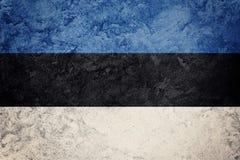 爱沙尼亚标志grunge 与难看的东西纹理的爱沙尼亚语旗子 图库摄影