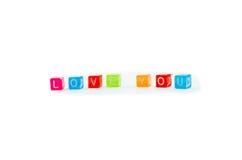 爱词摘要 在白色背景的被隔绝的五颜六色的小cubesd 免版税图库摄影