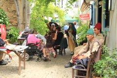 """爱琴海区域-博兹贾岛海岛、爱情小说""""前封信件""""电影的演员和服装 免版税图库摄影"""