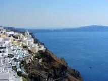 爱琴海小船fira老santorini海运视图火山 免版税图库摄影