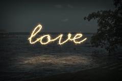 爱黄色闪闪发光字体 库存图片