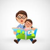 父亲和儿子一起阅读书 库存照片