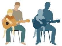 父亲和儿子吉他 免版税库存照片