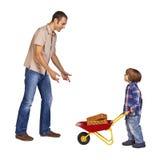 父亲和儿子在工作 图库摄影