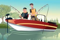 父亲和儿子捕鱼 库存图片