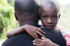父亲和儿子杂乱的一团互相反对 库存照片