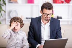父亲和儿子 免版税库存照片