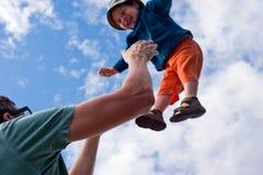 父亲和飞行儿子 库存照片