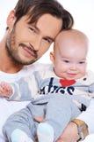 父亲和婴孩的特写镜头portait 免版税库存照片