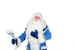 父亲圣诞节在他的手上拿着一个职员在白色背景 库存图片